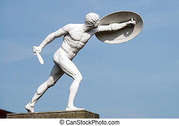 Statue of a naked male warrior at the Charlottenburg Palace in B