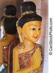 Statue of a praying Buddha