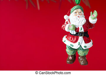 statue of a santa claus hanging on christmas tree