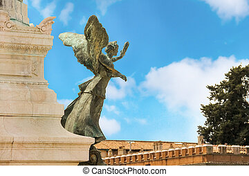Statue of a winged woman in the monument to Victor Emmanuel II.