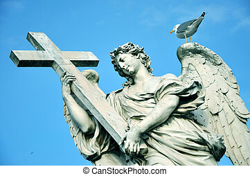 Statue of angel with holy cross