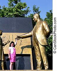 Statue of Ataturk with child symbol