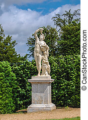 statue of Bacchus with grape in the Gardens of Versailles, France