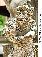 Statue of Balinese demon in Ubud, Indonesia
