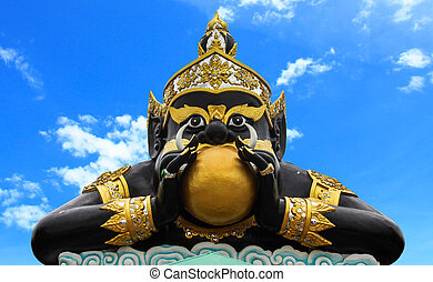 Statue of black deity called Rahu and India god, The black giant eating the moon.