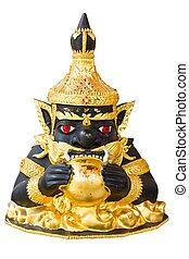 Statue of black deity called Rahu on white background