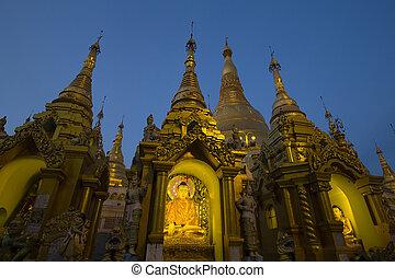 Statue of Buddha at Shwedagon Pagoda in Yangon, Myanmar, Burma. Night view