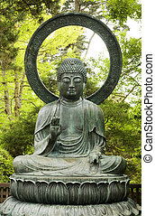 Statue of Buddha with Trees in Background - Statue of Buddha...