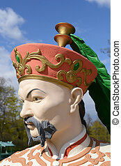 Statue of Chinese men.