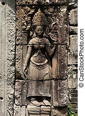 Statue of crowned woman on temple wall