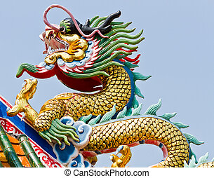 Statue of dragon on roof