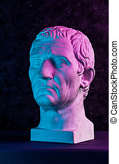 Statue of Guy Julius Caesar Octavian Augustus. Creative concept colorful neon image with ancient roman sculpture Guy Julius Caesar Octavian Augustus head. Cyberpunk, vaporwave and surreal art style.