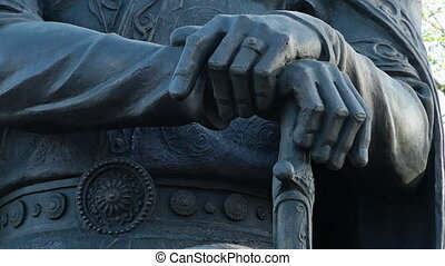 Statue of Hands on Top of a Sword - Steady, extreme close up...