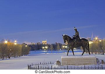 Statue of her Majesty Queen Elizabeth II riding a horse in front of the legislative building in Regina, Canada