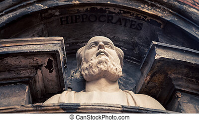 Bust of Hippocrates above a doorway in amsterdam