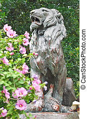 Statue of hunted lion in the city park