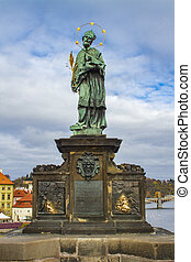 View at statue of John of Nepomuk on Charles Bridge in Prague, Czech Republic
