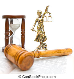 statue of justice, gavel, law book and hourglass on a white...