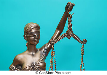 Statue of justice isolatedstatue of justice on a blue background