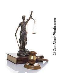 statue of justice, judge's hammer behind books on a white background