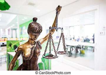 statue of justice. Lady justice with a school background