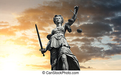 Statue of Lady Justice (Justitia) with sunset sky - The...