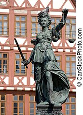 Statue of Lady Justice with a sleeping pigeon