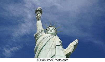 Statue of Liberty with floating sky background