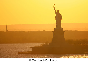 Statue of Liberty in New York City at sunset