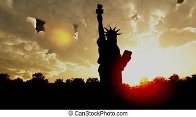 Statue of Liberty on the background of sunset and cloudy sky