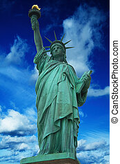 Statue of Liberty with bright blue cloudy sky, New York