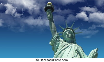 Statue of liberty with looping cloud background.