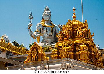 Statue of Lord Shiva. An old Hindu temple with architectural Golden detail. Murudeshwar. Karnataka, India