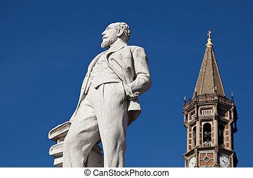 Statue of Mario Cermenati in Lecco Italy