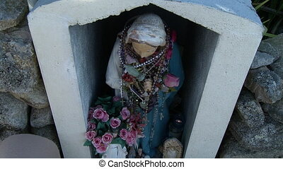 Statue Of Mary Wrapped In Rosaries