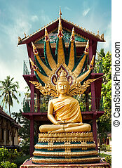 Statue of meditating Buddha in traditional theravada style....