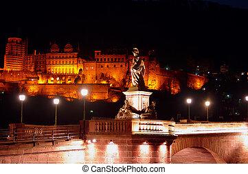 Statue of Minerva on Old Bridge in Heidelberg at night, Germany