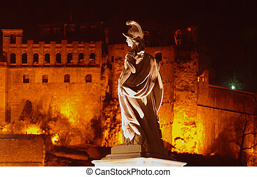 Statue of Minerva on Old Bridge in Heidelberg at night, Germany