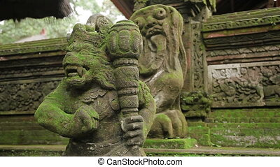 Statue of mythical animals. Mossy sculptures in Monkey...