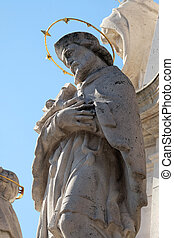 Statue of Saint John of Nepomuk, detail of Holy Trinity plague column in front of Matthias Church in Budapest, Hungary