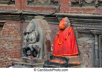 Statue of Shiva painted in red