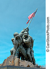 Statue of soldiers with the American Flag