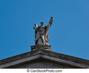 Statue of St. Andrew on the gable of a church