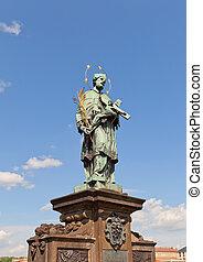 Statue of St. John of Nepomuk on Charles Bridge in Prague