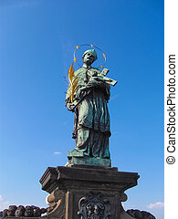 Statue of St. John of Nepomuk on the Charles bridge in Prague, Czech republic.