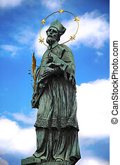 Statue of St. John of Nepomuk on the Charles Bridge (Karluv Most) in Prague, Czech Republic