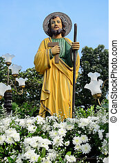 St. Joseph - Statue of St. Joseph surrounded with flowers...