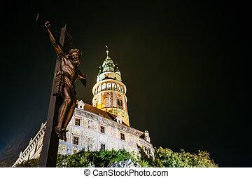 Statue of the Christian cross with Jesus in Cesky Krumlov, Czech republic