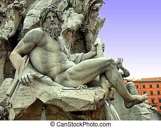 Statue of the god Zeus in a fountain (Fontana Dei Quattro Fiumi) in Piazza Navona (Rome - Italy)