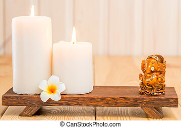 statue of the Hindu god Ganesha and religious candles